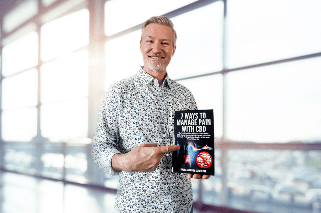 CBD expert and advocate David Schroeder holding his book.