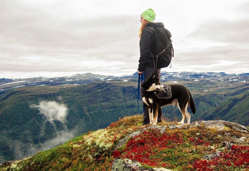 woman-hiking-with-dog